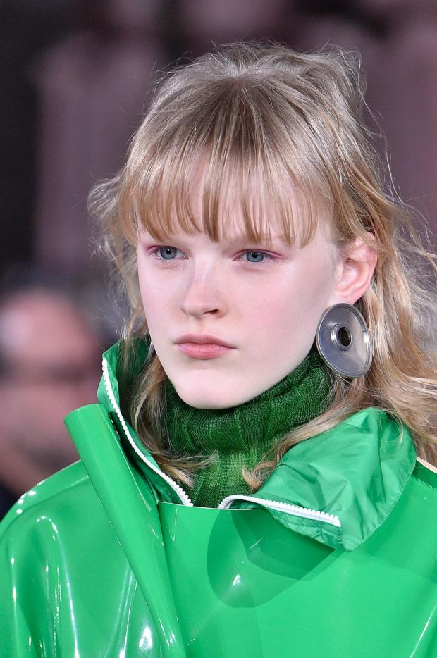 A model wears a green jumper and jacket at Marni's autumn/winter 2018-2019 fashion show in Milan. Photograph: Victor Virgile/Gamma-Rapho via Getty Images