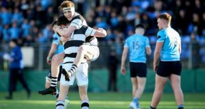 Belvedere's David Lacey celebrates with Ted Walsh after landing the winning conversion with the final kick of the game in the  Bank of Ireland Leinster Schools Senior Cup semi-final against St Michael's at Donnybrook Stadium. Photograph: Gary Carr/Inpho