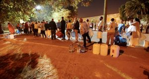 People queued to collect water from a spring in the Newlands suburb of Cape Town, South Africa, in January as fears over the city's water crisis grew. Photograph: Mike Hutchings/Reuters