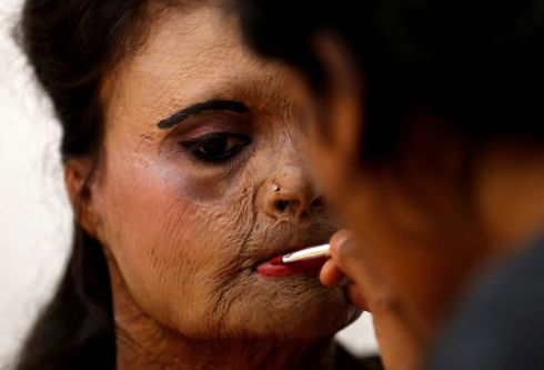 I'M A SURVIVOR: An acid attack survivor has her make-up applied backstage prior to a fashion show to mark International Women's Day in Thane, near Mumbai, India. Photograph: Danish Siddiqui/Reuters