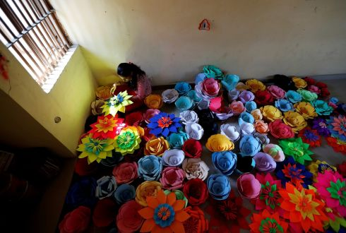 INTERNATIONAL WOMEN'S DAY: An inmate at Tihar Jail, the largest complex of prisons in South Asia, makes decorations for an event to mark International Women's Day in New Delhi, India. Photograph: Cathal McNaughton/Reuters