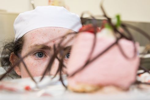 CULINARY ART: Orla McCarthy, from Midleton, Co Cork, a second-year culinary student at Cork Institute of Technology, wraps up her final piece, a Raspberry Bavarois, in the CIT Innovative desserts competition, as part of CIT's Innovation Week 2018. Photograph: Darragh Kane