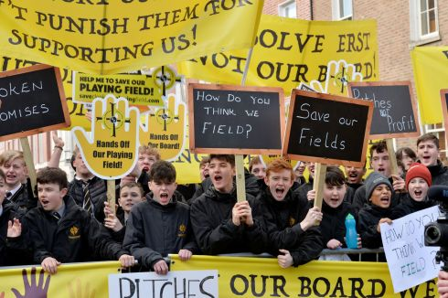 SALE PROTESTED: Students at Clonkeen College in south Dublin protest at the Dáil over the proposed sale of sports grounds at the school to developers. Photograph: Alan Betson/The Irish Times