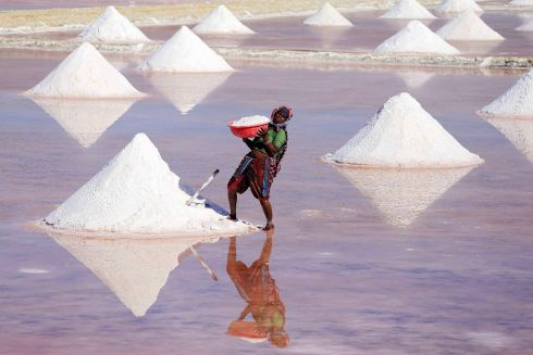 SALTY LABOUR: A female Indian labourer piles up salt in heaps to dry out in Nagaur district in the state of Rajasthan, India, ahead of International Women's Day. Photograph: Himanshu Sharma/AFP/Getty Images