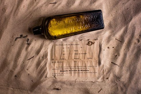 "MESSAGE IN A BOTTLE: The world's oldest known ""message in a bottle"" has been found half-buried in sand dunes on Australia's west coast. The message is almost 132 years old. It was discovered near Wedge Island, some 160km north of Perth. Photograph: Kym Illman/AFP/Getty Images"
