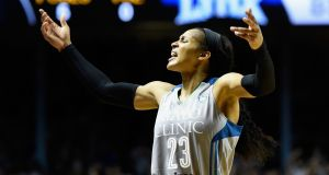 Maya Moore of the Minnesota Lynx and team-mates Seimone Augustus, Lindsay Whalen, and Rebekkah Brunson caused a stir in 2016 by wearing T-shirts criticising policing in the US. Photograph: Hannah Foslien/Getty Images