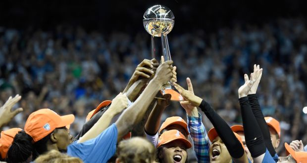 b814259ee36c The Minnesota Lynx raise the Championship trophy after defeating the Los  Angeles Sparks in Game Five