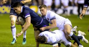 Scotland's Sean Maitland is tackled by England's George Ford.  The Scots  like to play a high-tempo game, quick throws and tap penalties and on turnover ball, look to exploit any space out wide.Photograph: Craig Watson/Inpho