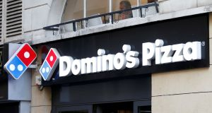 Domino's Group is focusing on sales through online channels to fend off competition from the likes of Just Eat. Photograph: Charles Platiau/Reuters