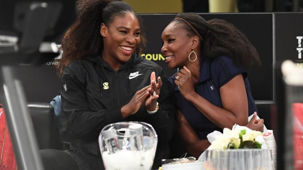 Serena Williams and Venus Williams in New York. Photograph: Timothy A Clary/AFP