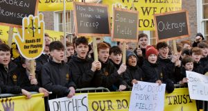 Students at Clonkeen College protesting at the Dáil on Wednesday over the proposed sale of the school's sports pitches to developers. Photograph: Alan Betson