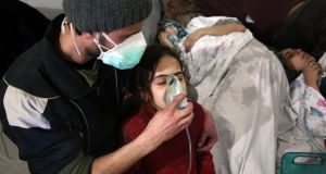 Syrians receive treatment for breathing difficulties at a clinic in Syria's Eastern Ghouta on March 7th  after regime air strikes which medics said  were consistent with a toxic attack. Photograph: Getty Images