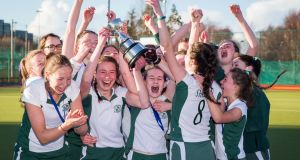 Loreto Foxrock celebrate with the trophy after their victory over St Andrew's in the final of the Leinster Schoolgirls Hockey Senior Cup final at UCD. Photograph:  Ryan Byrne/Inpho