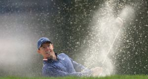 Rory McIlroy  plays a shot from a bunker on the 12th hole during the first round of the Valspar Championship at Innisbrook Resort Copperhead Course  in Palm Harbor, Florida. Photograph: Sam Greenwood/Getty Images