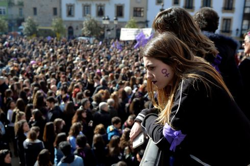 A woman with a female gender symbol on her cheek observes a demonstration for women's rights in Bilbao. Photograph: Vincent West / Reuters