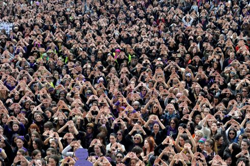 Protesters form triangles with their hands during a demonstration for women's rights in Bilbao, Spain. Photograph: Vincent West / Reuters