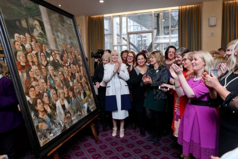 Women members of the Oireachtas with the new painting featuring all 53 female members of the Dail and Seanad which was unveiled in Leinster House.   Photograph: Maxwells