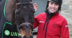 Sizing John, pictured here with  Kate Harrington, will not defend next week's Cheltenham Gold Cup.  Photograph: Niall Carson/PA Wire