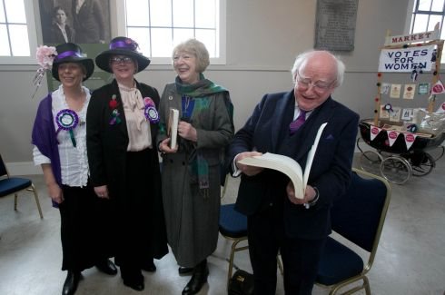 Community Workers dressed as suffragettes Cathy Fagan & Paula Jones present gifts to Sabina Higgins & President of Ireland Michael D Higgins during an International Women's Day Event  - A Celebration of Women & Women's Suffrage- organised by The Family Resource Centre, Pimlico at Richmond Barracks, Inchicore, Dublin.  Photograph: Gareth Chaney / Collins