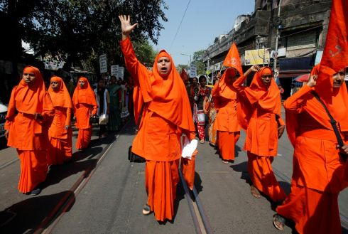 Hindu nuns shout slogans during a rally to mark the International Women's Day in Kolkata, India. Photograph: Rupak De Chowdhuri / Reuters