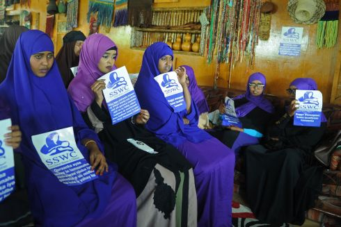 "Somali female activists hold messages ""Save Somali Women and children"" gather to mark International Womens Day in Mogadishu. Photograph: Mohamed Abdiwab   / AFP"