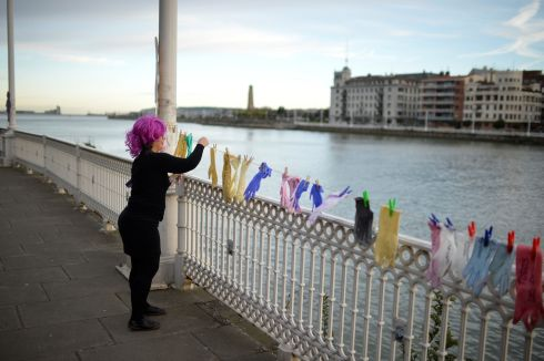 A protester hangs gloves with messages while taking part in a strike for women's rights in Portugalete, Spain. Photograph: Vincent West / Reuters