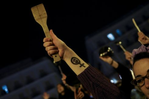 Women bang pots and pans during a protest at the start of a nationwide feminist strike on International Women's Day at Puerta del Sol Square in Madrid. Photograph: Susana Vera / Reuters