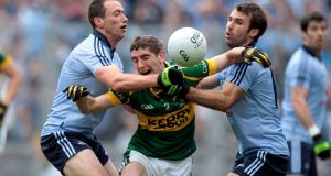 Dublin's Barry Cahill and Brian Cullen tackle Killian Young during the 2011 All-Ireland final. Cahill says no league match, especially against Kerry, is lightly conceded. Photograph: Cathal Noonan/Inpho
