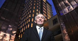 Developer Michael O'Flynn   in front of the   tower, which his group built in 2008, just as the Republic's property market was collapsing. Photograph: Daragh Mac Sweeney/Provision