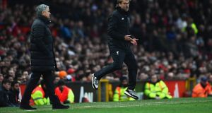 Jurgen Klopp and Jose Mourinho during last year's fixture at Old Trafford. Photograph: Laurence Griffiths/Getty Images