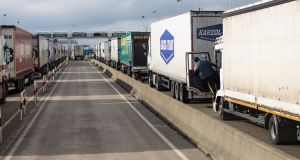 Lorries wait to board a freight train in Calais. Photograph:  Jack Taylor/Getty Images