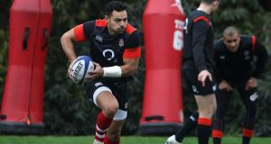 Ben Te'o runs with the ball during an England training session held at Pennyhill Park this week. Photograph: David Rogers/Getty Images