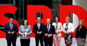 Andrea Nahles (SPD) presenting  designated ministers Hubertus Heil,  Fraziska Giffey, Heiko Mass, Katarina Barley, Svenja Schulze and Olaf Scholz  at the party headquarters in Berlin, Germany. Photograph:  Reuters