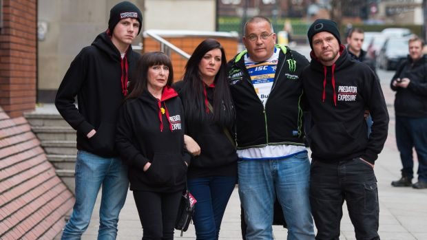 Members of paedophile-hunting group Predator Exposure outside Leeds Crown Court after the sentencing. Creaven was detained by the group after he travelled to the UK to meet what he thought was a 13-year-old girl. Photograph: Peter Powell/PA Wire