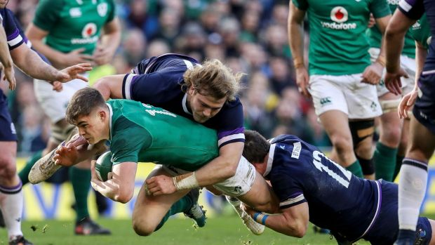 Ireland's Garry Ringrose tackled by David Denton and Pete Horne of Scotland. Photograph: Tommy Dickson/Inpho