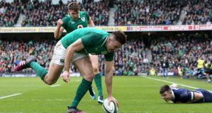 Ireland's Jacob Stockdale scores one of his two  tries during the  Six Nations match against Scotland at the Aviva Stadium. Photograph:  Brian Lawless/PA Wire