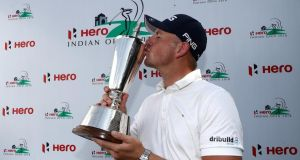 Matt Wallace with the Hero Indian Open trophy. Photograph: Matthew Lewis/Getty