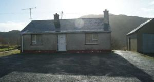 Mark McConnell Auctioneers is seeking €120,000 for this two-bedroom bungalow beside Lough Finn in Lifford, Co Donegal