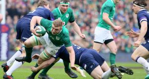 Ireland flanker Dan Leavy is tackled by Scotland's prop Simon Berghan at the Aviva Stadium. Photograph: Paul Faith/AFP/Getty