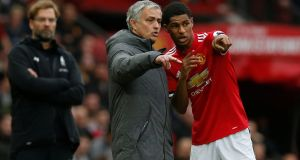 Manchester United manager José Mourinho giving instructions to Marcus Rashford during the match against Liverpool at Old Trafford. Photograph:  Reuters/Andrew Yates