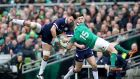 Scotland's Ryan Wilson and man of the match, Ireland's Rob Kearney, contest an aerial ball during the Six Nations clash at the Aviva Stadium. Photograph: Ryan Byrne/Inpo ane