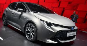 The new Toyota Auris hybrid model car, is seen at the stand of Japanese carmaker during the Geneva International Motor Show last week. Photograph:  Fabrice Coffrini/AFP/Getty Images