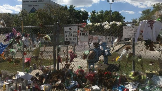 Flowers placed outside Marjory Stoneman Douglas high school in Parkland, Florida. Photograph: Suzanne Lynch