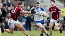 Conor McManus is tackled by Gary O'Donnell during Monaghan's win over Galway. Photograph: Laszlo Geczo/Inpho