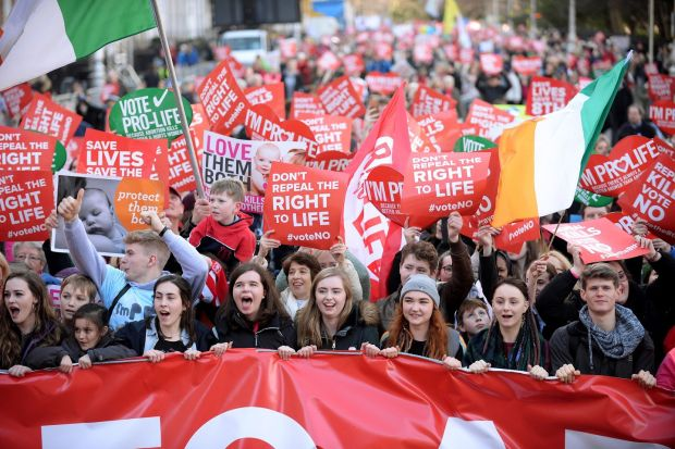 Anti-abortion protesters march through Dublin to campaign for the Eighth Amendment of the constitution to be retained in this summer's referendum. Photograph:: Caroline Quinn/PA