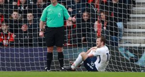 Tottenham's Harry Kane sustains an injury after having a goal disallowed in their win over Bournemouth. Photo: Ian Walton/Reuters
