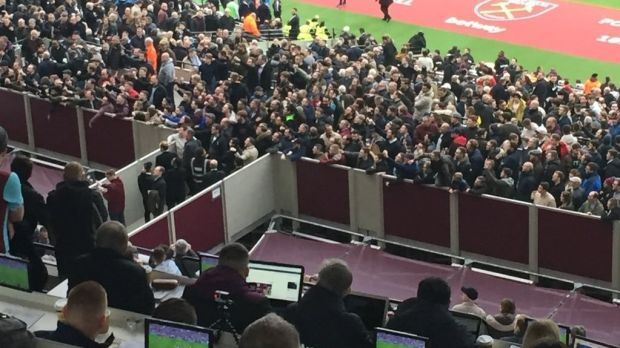 Fans gather in front the directors box in order to vent their frustrations against the West Ham United owners. Photo: Andy Sims/PA Wire
