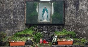 A shrine in the corner of part of the site of the former mother-and-baby home where the remains of an unknown number of infants were found buried, in Tuam. Photograph: Reuters