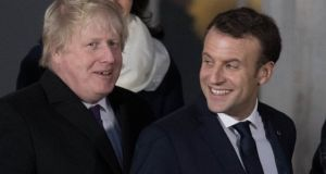 Boris Johnson and Emmanuel Macron at Sandhurst in January. Photograph: Getty Images