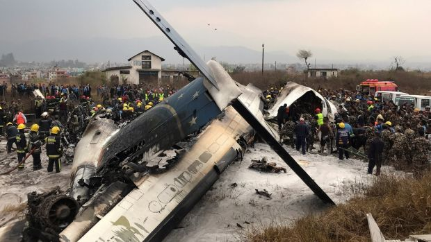 Wreckage of an airplane is pictured as rescue workers operate at Kathmandu airport, Nepal. Photograph: Navesh Chitrakar/Reuters